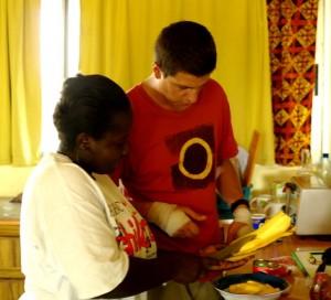 Veronica teaching Skott to slice the plantains diagonally