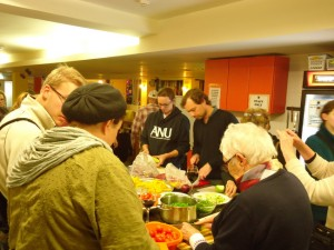 Some of the Shabbat dinner crew chopping up all kinds of veggies